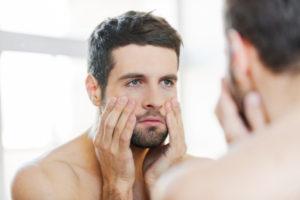 analysing skin in the mirror